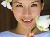 Phuket, Thailand --- Beautiful Woman With a Flower in Her Hair --- Image by ? Ken Seet/Corbis